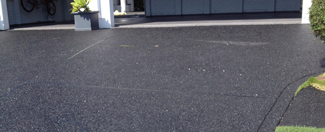 Treating cement cracks through resurfacing services for Temperature to pour concrete driveway